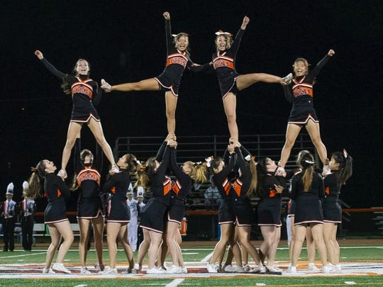 Tenafly's cheerleaders performing at the school's football
