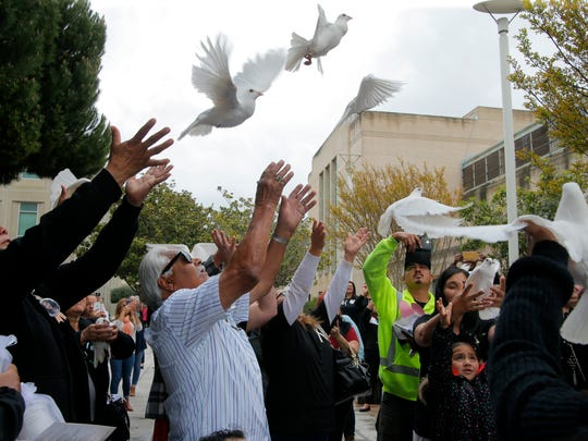 Crime victim survivors release doves in the air at the close of the 18th annual Victims' Dedication Ceremony.