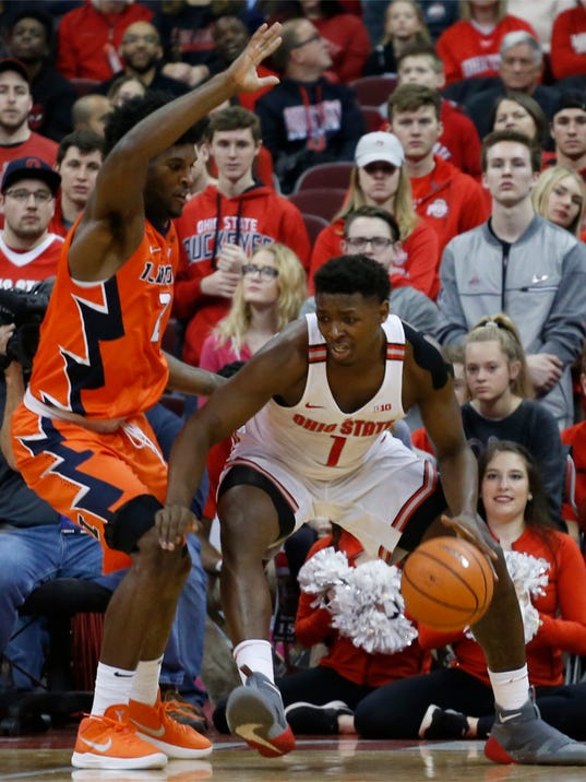 Ohio State's Jae'Sean Tate, right, posts up against Illinois' Kipper Nichols during the first half of an NCAA college basketball game Sunday, Feb. 4, 2018, in Columbus, Ohio. (AP Photo/Jay LaPrete)