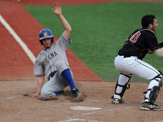 Buena's Denny Brady slides across home plate for a run during the Chiefs' 7-2 victory over Robbinsville in the Group II state semifinals on Tuesday<137> at Rutgers<137>.