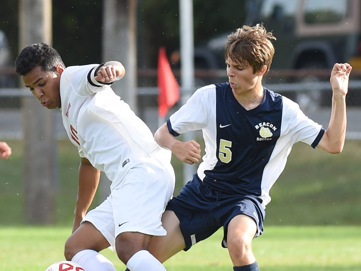 From left, Roy C. Ketcham's Daniel Veliz and Beacon's Alec Druckenmiller battle for the ball during Tuesday's game in Wappingers Falls.