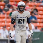 Utah State safety Brian Suite waits for the next play Nov. 1, 2014, in Honolulu.