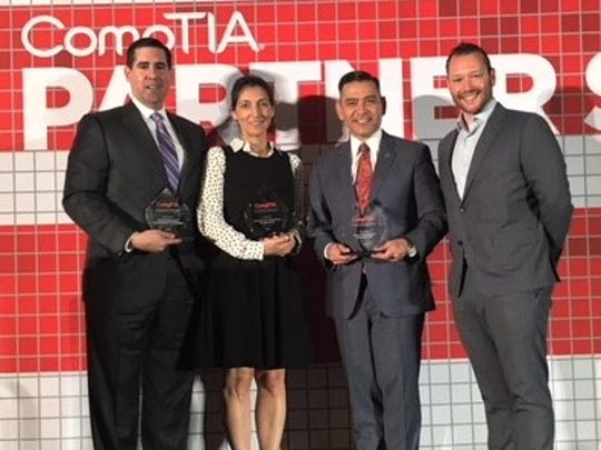 Leila Melendez, chief operating officer at Workforce Solutions Borderplex, receives an award for the agency's special IT certification program at the July CompTIA Partner Summit in Washington, D.C. She is with Alex Meade, left, executive director of Mission EDC in Mission, Texas; Texas Workforce Commissioner Julian Alvarez III; and Mark Bennet, with the CompTIA program.