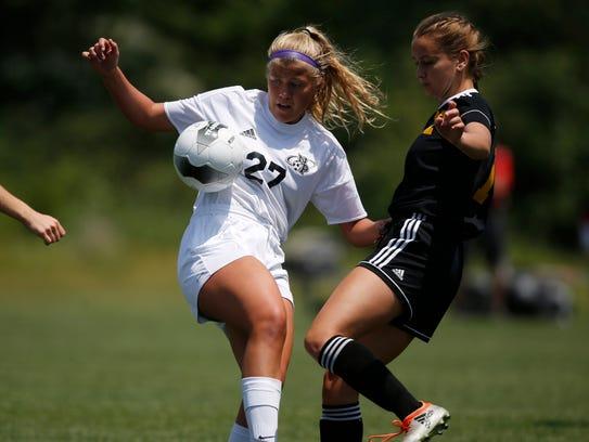North Polk junior Maddie Bruggeman (27) tries to keep