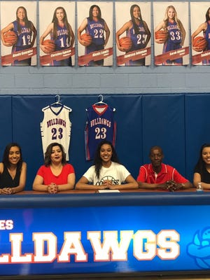 Las Cruces High's Janessa Johnson, third from left, signed to play basketball for Cochise College in Arizona.