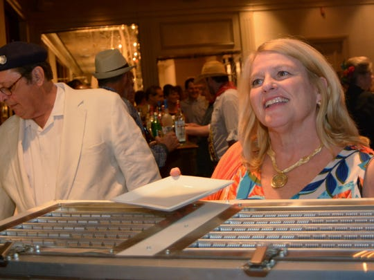 """Richard and Meg Goorley at the Krewe Justinian Midway to Mardi Gras Party - """"Cruisin' to Cuba"""" at the Petroleum Club."""