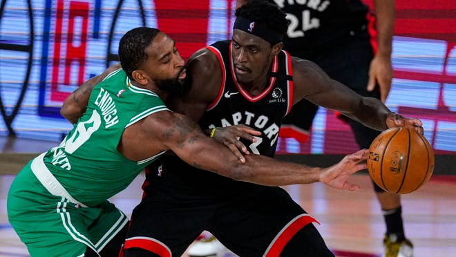 Raptors forward Pascal Siakam drives on Celtics guard Kemba Walker during the second half of Game 6 on Wednesday night.