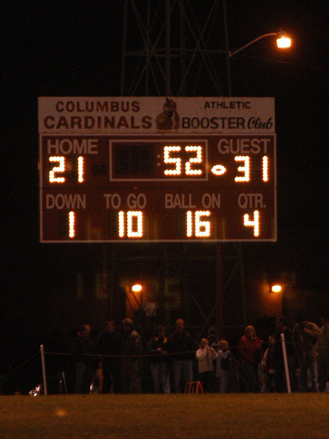 The scoreboard shows Cambridge leading Columbus after an interception sealed the victory in the 2004 regular-season finale.