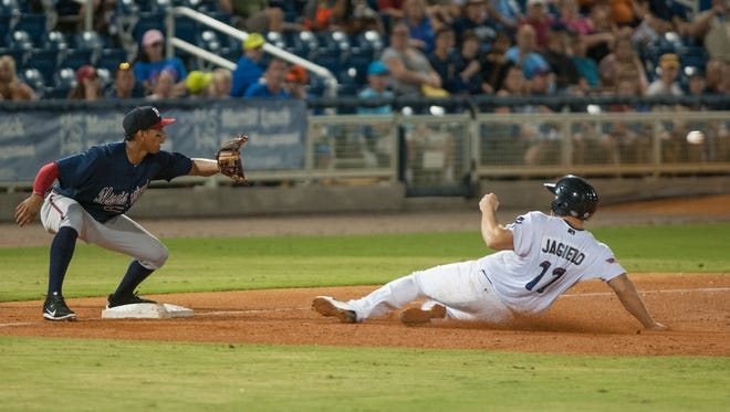 Eric Jagielo (17) safely slides into third base ahead of the throw to Johan Camargo (1) during the Mississippi Braves vs. Blue Wahoos baseball game at Blue Wahoos Stadium in Pensacola, FL on Wednesday, August 3, 2016.