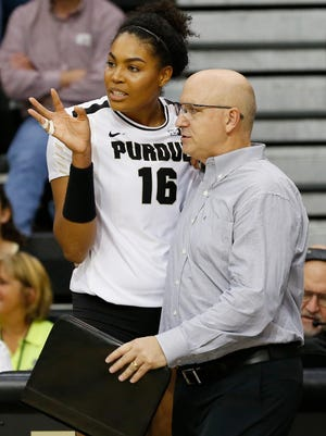 Purdue head coach Dave Shondell speaks with Sherridan Atkinson as the Boilermakers face Maryland Wednesday, November 2, 2016, at Holloway Gymnasium. Purdue defeated Maryland 25-23, 25-15, 16-25, 28-26.