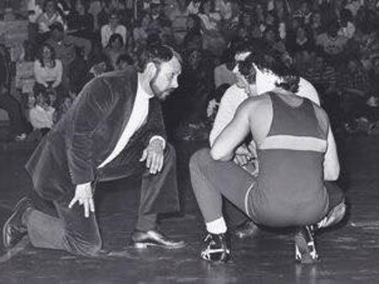 Hall of Fame wrestling coach Ken Pagach, left, who