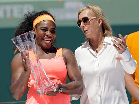 """FILE - This is a Saturday, April 4, 2015, file photo of former tennis star Martina Navratilova, right,  as she poses with Serena Williams, after Williams won the women's final match at the Miami Open tennis tournament, in Key Biscayne, Fla. Martina Navratilova says she is """"angry"""" and feels let down by the BBC after learning that John McEnroe gets paid at least 10 times more than her for their broadcasting roles at Wimbledon. McEnroe earns between 150,000-199,999 pounds ($210,000-280,000) for working at Wimbledon while Navratilova says she gets paid 15,000 pounds ($21,000). The BBC says Navratilova appears on fewer broadcasts and is on a different type of contract than McEnroe. (AP Photo/Alan Diaz/File)"""