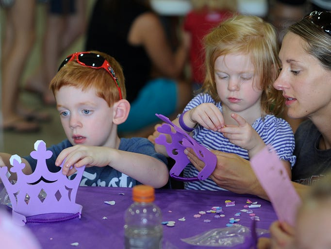 Alecia Pluess, right, talked with her daughter Ada Pluess, as she and her brother Oakley Pleuss, left, made crowns for themselves Saturday Aug, 30, 20214 during a Build-a-Crown event at the Central Wisconsin State Fair in Marshfield. The trio is from Wisconsin Rapids.