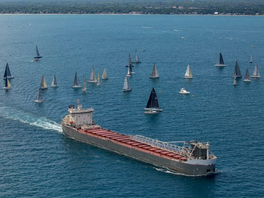 The freighter Manitoulin passes boats during the start