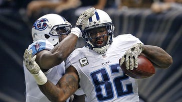 """Titans tight end Delanie Walker is among five finalists for the NFL Players Association's annual Byron """"Whizzer"""" White Award."""