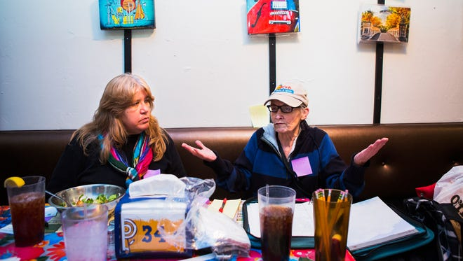 February 3, 2017 - Faye Hawks (left) listens to organizer Bonnie Chidester during a post-Women's March meeting at The Trolley Stop restaurant. Five attendees at the meeting discussed their feelings following President Donald Trump's inauguration.