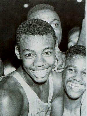 Oscar Robertson and teammates celebrate Crispus Attucks' state basketball championship in 1955.