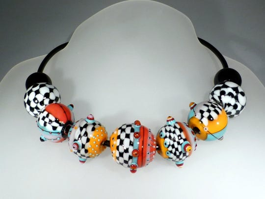 Creative handblown glass bead necklace by South African artist Astrid Riedel.