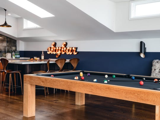 Games, a pool table,comfortable furniture and a bar