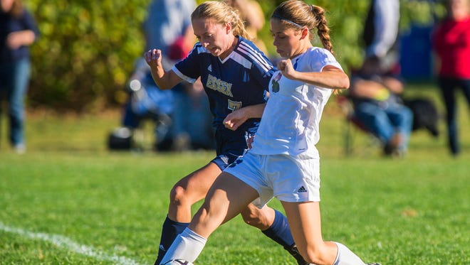 Colchester's Avery Finelli, right, and Essex's Kristen Roberge chase down the ball in Colchester on Wednesday, October 5, 2016.