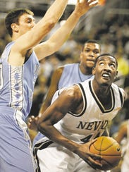 Nevada's Dario Hunt tries to go up for a shot during