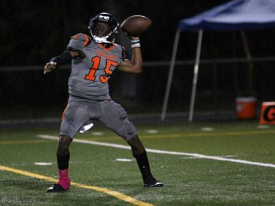 Lely quarterback Jonis Dieudonne passes during the