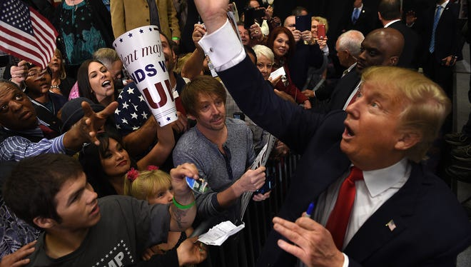 Republican presidential candidate Donald Trump greets his supporters after speaking during a campaign rally at the Nugget Hotel and Casino in Sparks on Oct. 29, 2015.