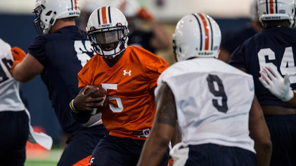 John Franklin III runs a play during Auburn's first day of practice on Wednesday, Aug. 3, 2016 in Auburn, Ala.