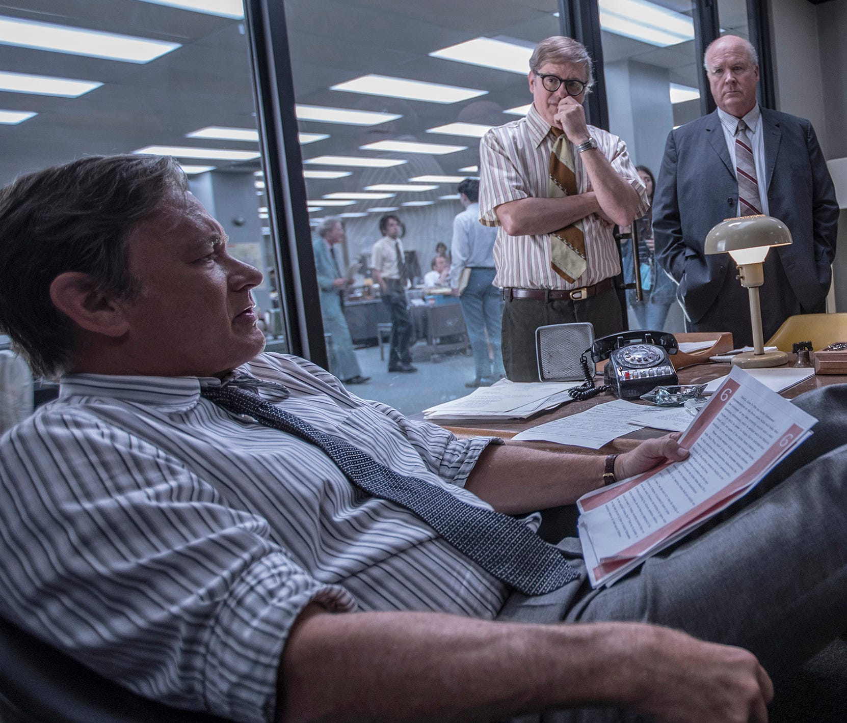 Ben Bradlee (Tom Hanks, at desk) rallies his crew for a major story in 'The Post.'