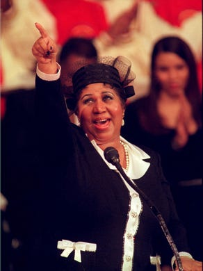 "Aretha Franklin sings, ""To dream the impossible dream"""
