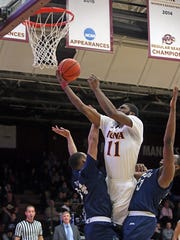 Iona College's Roland Griffin (11) goes up for two