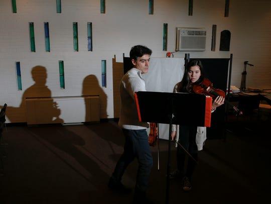 Yuliyan Stoyanov, left, talks with Madelyn Deininger,
