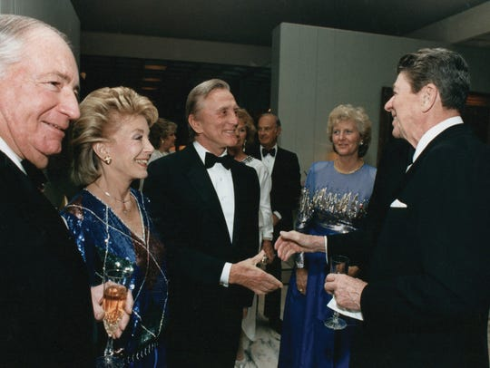 Kirk and Anne Douglas greet President Ronald Reagan