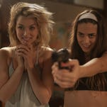 "Lorenza Izzo (from left), Ana De Armas and Keanu Reeves in ""Knock Knock."""