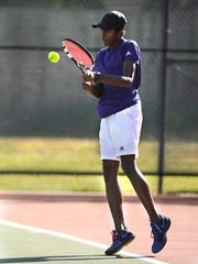 Wylie's Nikhil Kalla returns a ball during the Bulldogs' team tennis win over Andrews in the Region I-4A championship match  on Friday, Oct. 28, 2016, at the Rose Park Tennis Center.