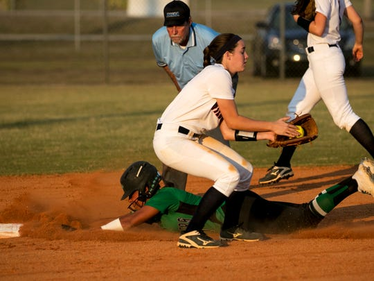 Hannah Gormly slides into second base safely as Estero short stop Chelsea Dumas catches the ball on Tuesday in the Class 7A regional softball semifinal at Estero High School.