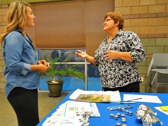 Brandy Garcia, left, chats with Water Conservation Program coordinator Rhonda Diaz at the recent water open house.