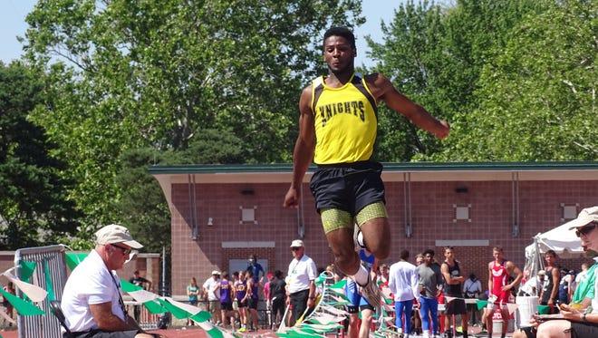 Northmor junior Demetrius Johnson wins his second DIII long jump title in three years.