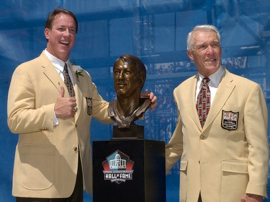 Jim Kelly and his presenter, Marv Levy, pose with Kelly's bust during the enshrinement ceremony.