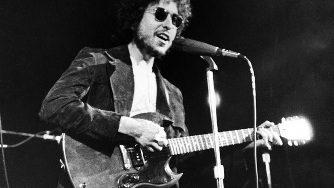 In this Jan. 1, 1972, file photo, Bob Dylan performs at the Academy of Music in New York.