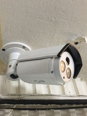 One of the 16 new cameras installed at the Department of Corrections is shown here. This one fixed to the ceiling is near the prison's main entrance.