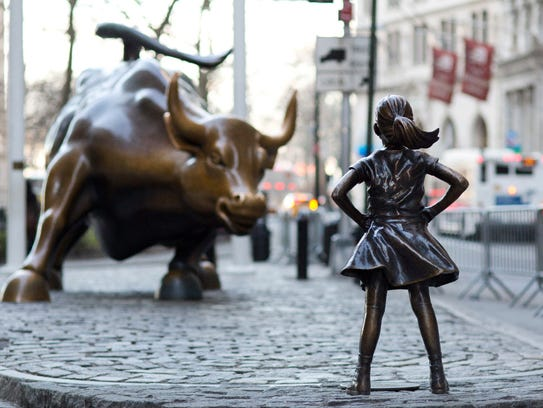 "The ""Charging Bull"" and ""Fearless Girl"" statues in"