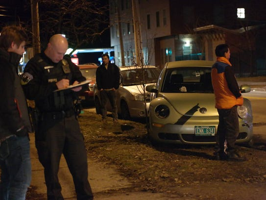 Police and residents in Burlington look over several