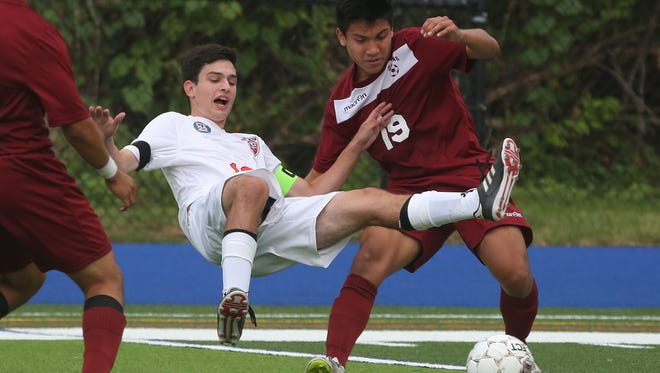From left, Greeley's William Seidman (10)  and Ossining Kenneth Jarama (19) battle for ball control during boys soccer game at Horace Greeley High School in Chappaqua Sept. 13,  2017. Greeley won the game 3-2.
