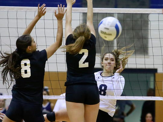 Piedra Vista's Bebe Jaquez, right, records a kill against Cibola during the District 1-6A tournament on Nov. 2 at the Jerry A. Conner Fieldhouse.