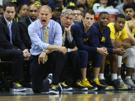 Michigan head coach John Beilein yells instructions