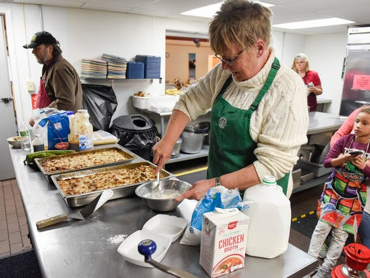 Volunteer Chris Pederson makes a frosting for the dessert Thursday, Nov. 9, 2017, at the Salvation Army.