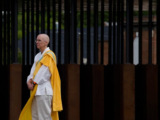 A Buddhist monk tours EJI's National Memorial for Peace