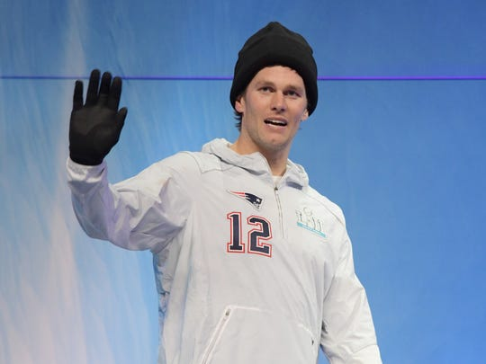 Jan 29, 2018; St. Paul, MN, USA; New England Patriots quarterback Tom Brady waves to the crowd from the stage during Super Bowl LII Opening Night at Xcel Energy Center. Mandatory Credit: Kirby Lee-USA TODAY Sports ORG XMIT: USATSI-379420 ORIG FILE ID:  20180129_jla_al2_130.jpg
