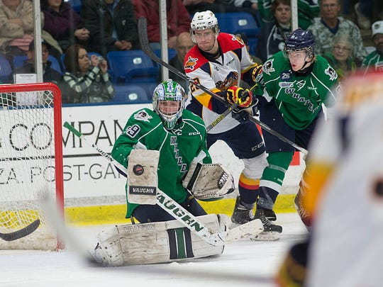 Making a blocker stop against Erie is Plymouth Whalers